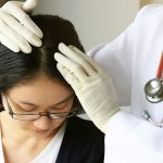 Hair health inspection to determine need for medicine or transplant.