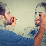 Man drawing his reflection