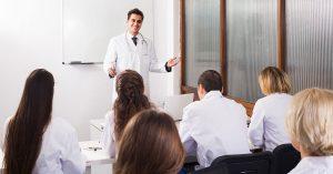 Professor teaching classroom about robotic hair restoration with ARTAS