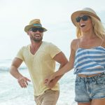 Couple wearing hats on the beach