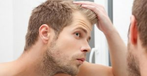 Man noticing hair loss