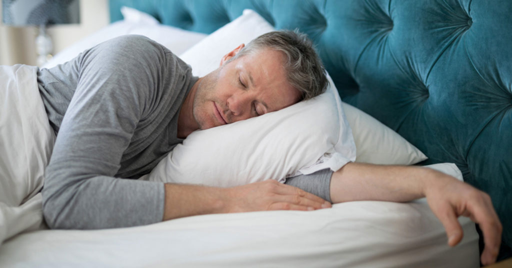 an older man with healthy hair sleeping