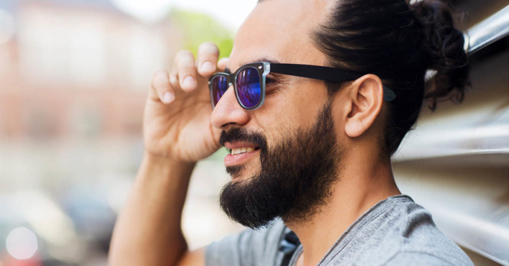 man with a tight man bun hairstyle