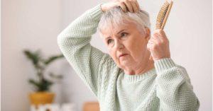 Woman with gray hair experiencing hair loss