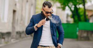 man smoking a vape